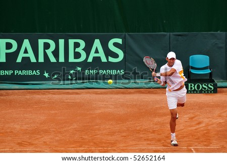 BUCHAREST, ROMANIA MAY 8: Romania's Horia Tecau executes a backhand during the Davis Cup meeting between Romania and Ukraine at the BNR Arenas on May 8, 2010 in Bucharest, Romania. - stock photo