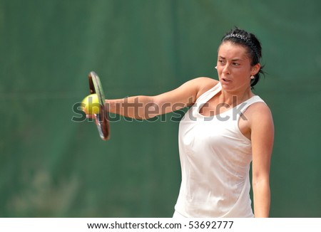 "BUCHAREST, ROMANIA - MAY 23: Romanian Diana Enache  is playing during the finals of the F1 Romanian Tennis Futures at ""Dinu Pescariu Club"" on May 23, 2010 in Bucharest, Romania. - stock photo"