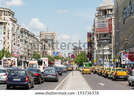 BUCHAREST, ROMANIA - MAY 19: Rush Hour At Unirii Square on May 19, 2014 in Bucharest, Romania. Unirii Square (Piata Unirii) Is one of the largest and busiest squares located in central Bucharest.