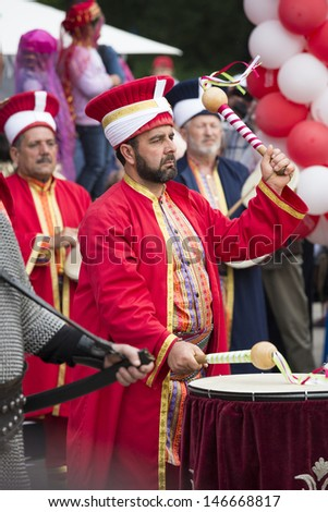 BUCHAREST, ROMANIA - MAY 17: Unidentified member of traditional military turkish band performes at drums during the celebratory events Turkish Festival on May 17, 2013 in Bucharest, Romania.