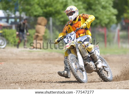 BUCHAREST, ROMANIA - MAY 14: Unidentified rider participates at the Third National Endurocross Championship on May 14, 2011 at Ciolpani in Bucharest, Romania