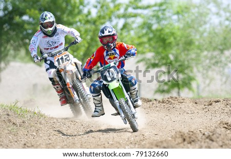 BUCHAREST, ROMANIA - MAY 14: Unidentified riders participates in the Third National Endurocross Championship on May 14, 2011 at Ciolpani in Bucharest, Romania