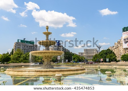 BUCHAREST, ROMANIA - MAY 28, 2016: Union Square Fountain And House Of The People Or Parliament Palace (Casa Poporului) View From Union Boulevard (Bulevardul Unirii) In Downtown Bucharest.