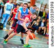 BUCHAREST, ROMANIA - MAY 20: Unknown basketball  players performs during the game Sport Arena Streetball 3x3, Play On (red) vs. Tiki Taka Polit (blue) on May 20, 2012 in Bucharest, Romania - stock photo