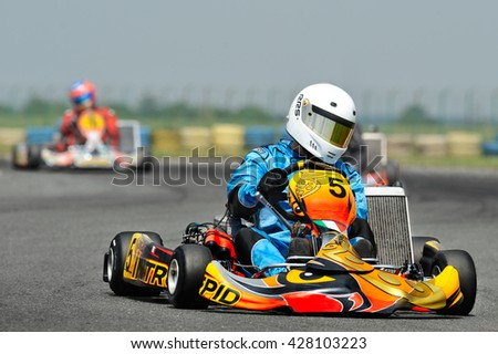 BUCHAREST, ROMANIA -MAY 17: Unknown pilots competing in National Karting Championship 2015 at Amkart Bucharest, on may 17, 2015 in Bucharest, Romania