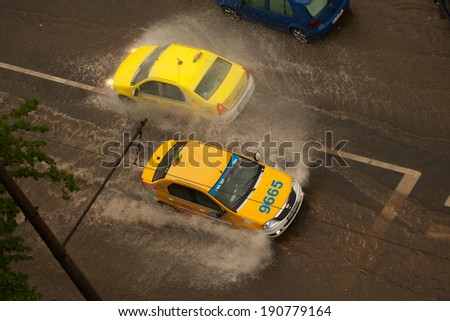 BUCHAREST ROMANIA - MAY 4: Weather anomalies covers all the transport routes with water May 4, 2014 in Bucharest, Romania. - stock photo