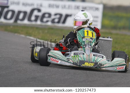 BUCHAREST, ROMANIA - NOV. 11: Alex Tomescu, number 11, competes in Karting Cup Romania, on november 11, 2012 in Bucharest, Romania.