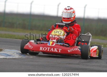BUCHAREST, ROMANIA - NOV. 11: Parvu Nicolae, number 90, competes in Karting Cup Romania, on november 11, 2012 in Bucharest, Romania.