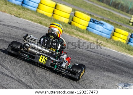 BUCHAREST, ROMANIA - NOV. 11: Vasile Didila, number 15, competes in Karting Cup Romania, on november 11, 2012 in Bucharest, Romania.
