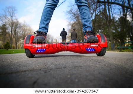 BUCHAREST, ROMANIA, - NOVEMBER 10, 2015: Child using hoverboard, a self-balancing two-wheeled board. The gyroscope based dual wheel electric scooter is also called a smart balance wheel