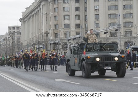 BUCHAREST, ROMANIA - NOVEMBER 29, 2015: Romanian soldiers carry flags as they participate at repetition for Romanian National Day parade, that takes place on the 1st of December.