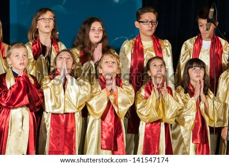 BUCHAREST, ROMANIA - NOVEMBER 04: unidentified members of the Carmina Tenera Children's Choir sing at the Week of Archangels Festival November 04, 2012 in Bucharest, Romania - stock photo
