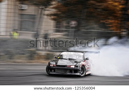 BUCHAREST,ROMANIA OCT.22 :Juha Rintanen drives a Nissan Skyline at Drift Grand Prix of Romania on October 22.2011 in Bucharest, Romania - stock photo