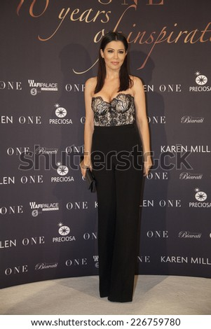 """BUCHAREST, ROMANIA - OCT 27, 2014:   Romanian TV presenter Simona Patruleasa arrives arrives at """"Gala The One"""", 10 years of inspiration on October 27, 2014 in Bucharest, Romania. - stock photo"""