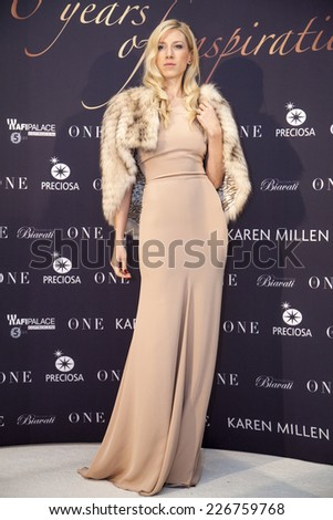 """BUCHAREST, ROMANIA - OCT 27, 2014:  TV presenter and designer jewelry, Sonia Argint-Ionescu arrives at """"Gala The One"""", 10 years of inspiration on October 27, 2014 in Bucharest, Romania. - stock photo"""