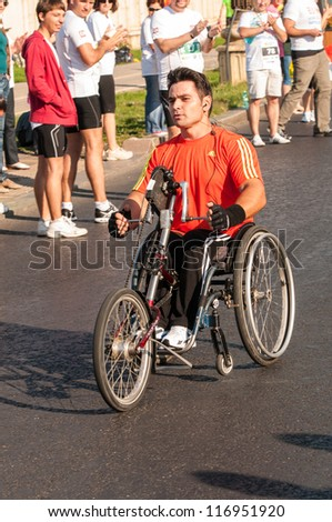 BUCHAREST, ROMANIA - OCTOBER 7: An unidentified marathon runner competes at the Bucharest International Marathon 2012, October 7, 2012 in Bucharest, Romania - stock photo
