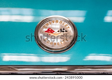 BUCHAREST, ROMANIA - OCTOBER 31, 2014: 1959 Chevrolet Corvette Car Sign. From 1953 the Corvette is a sports car manufactured by Chevrolet division of American automotive conglomerate General Motors. - stock photo