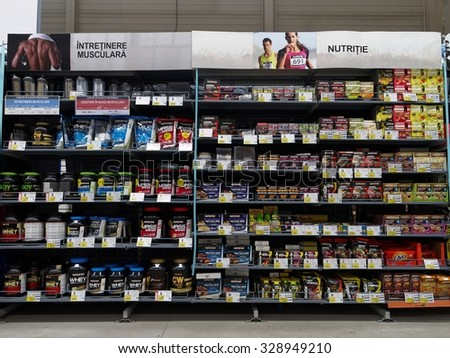 BUCHAREST, ROMANIA - OCTOBER 17, 2015. Decathlon store - sports nutrition supplements area. Decathlon is one of the world's largest sporting goods retailers with more than 850 stores in 22 countries. - stock photo