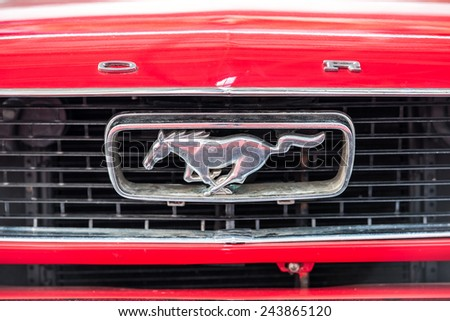 BUCHAREST, ROMANIA - OCTOBER 31, 2014: 1966 Ford Mustang Sign Close Up. The Ford Mustang is an automobile manufactured by the Ford Motor Company and was introduced on April 17, 1964. - stock photo