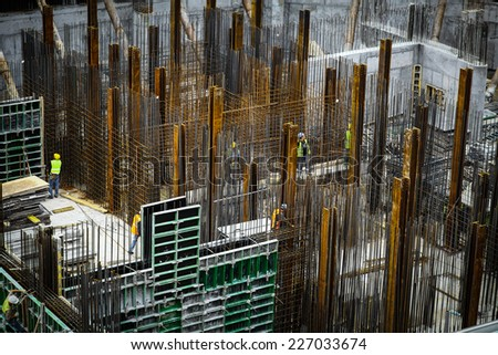 Bucharest, Romania - October 9, 2014: General view of some workers on a construction site in Bucharest, Romania. - stock photo