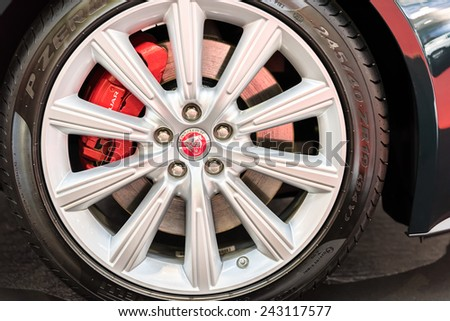 BUCHAREST, ROMANIA - OCTOBER 31, 2014: Jaguar Sign On Wheel And Break Pad. Founded in 1922 it is a British multinational luxury car manufacturer headquartered in Coventry, England.