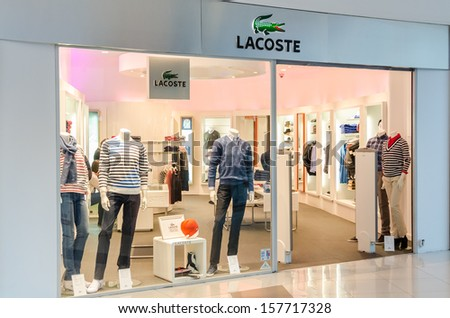 BUCHAREST, ROMANIA - OCTOBER 09: Lacoste Store on October 09, 2013 in Bucharest, Romania. Is a French clothing company founded in 1933 that sells high-end clothing and most famously polo shirts.
