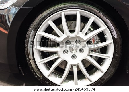 BUCHAREST, ROMANIA - OCTOBER 30, 2014: Maserati Sign On Wheel And Break Pad. Maserati is an Italian luxury car manufacturer established in 1914 in Bologna and its emblem is a trident. - stock photo