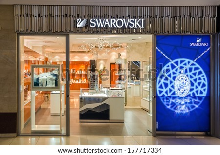 BUCHAREST, ROMANIA - OCTOBER 09: Swarovski store on October 09, 2013 in Bucharest, Romania. The Swarovski Crystal range includes home decoration objects, jewelry and couture, and chandeliers. - stock photo