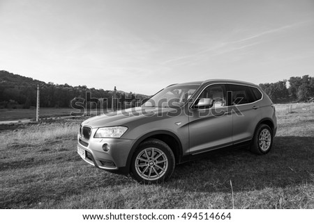 Bucharest, Romania - October 1, 2016: View of a 2014 BMW X3 F25 on a typical autumn landscape.