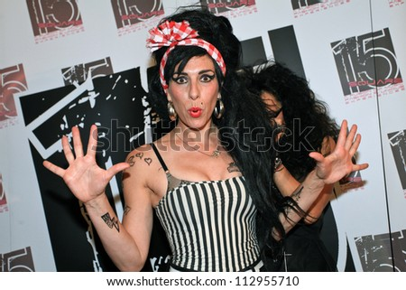BUCHAREST, ROMANIA - SEPT 15: Merante Tamar van Amersfoort, official replica of singer Amy Winehouse, perform a concert at the event of reopening of a club in Bucharest, Saturday, August 15, 2012 - stock photo