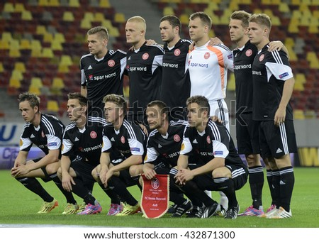BUCHAREST, ROMANIA - SEPTEMBER 18, 2014: Aab Aalborg line up pictured prior to the UEFA Europa League game between Steaua Bucuresti and Aalborg on National Arena. - stock photo