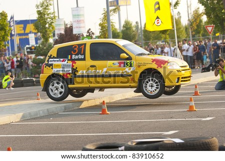 BUCHAREST,ROMANIA - SEPTEMBER 02: Barbu Bogdan drives a Renault Clio car during Rally of Romania 2011 championship on September 02, 2011 in Bucharest, Romania.
