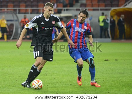 BUCHAREST, ROMANIA - SEPTEMBER 18, 2014: Nicklas Helenius and Andrei Prepelita pictured during the UEFA Europa League game between Steaua Bucuresti and Aalborg on National Arena. - stock photo