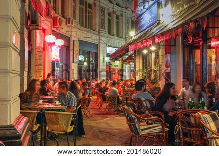 BUCHAREST, ROMANIA - SEPTEMBER 20: Night scene of the Macca-Vilacrosse Passage in the old town of Bucharest, Romania on September 20, 2013. The historical passage today hosts several establishments. - stock photo