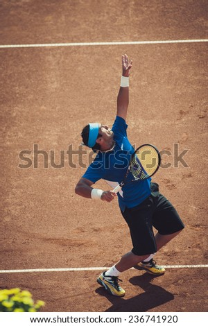 BUCHAREST, ROMANIA - SEPTEMBER 17: Unidentified tennis player in action during BRD Nastase Tiriac Trophy on September 17, 2011 in Bucharest, Romania - stock photo