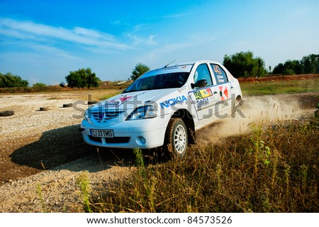 BUCHAREST, ROMANIA - SEPTEMBER 02: Unknown car driver piloting his car at Barsa Rally 2011 stage Shakedown at Ciolpani on September 02, 2011 in Bucharest, Romania - stock photo