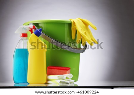 bucket and detergents on the gray background