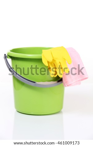 bucket and rubber hand glove on the white background