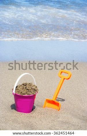 Bucket and spade for the beach - stock photo