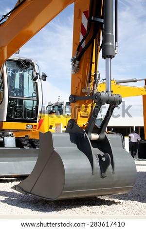 Bucket Loader excavator closeup, construction machinery - stock photo