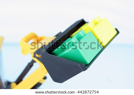 Bucket of bulldozer toy. - stock photo