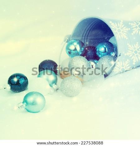 Bucket of Christmas balls on winter background.  - stock photo