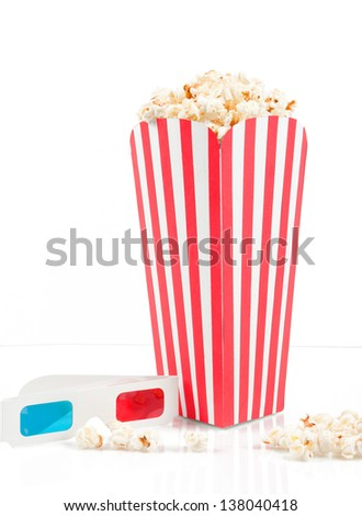 Bucket of popcorn with 3D glasses on white background - stock photo