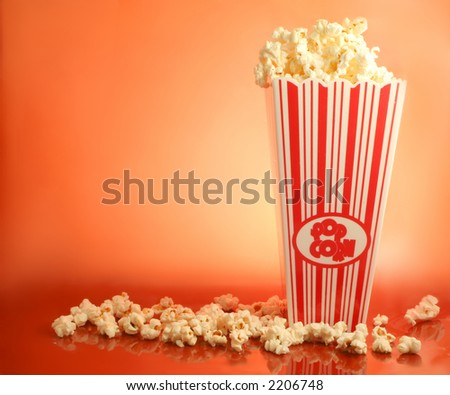 bucket of warm  and delicious microwaved  popcorn - stock photo