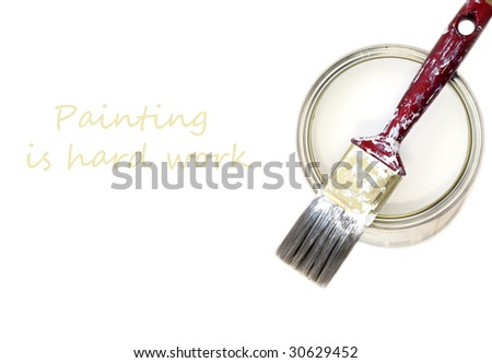 Bucket of white paint and a synthetic brush - stock photo