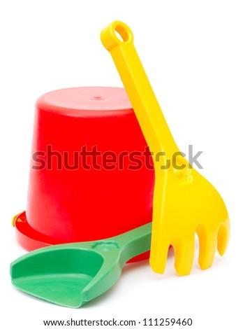bucket, shovel and rake, toys, isolated - stock photo