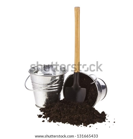 Bucket, spade, soil on white background
