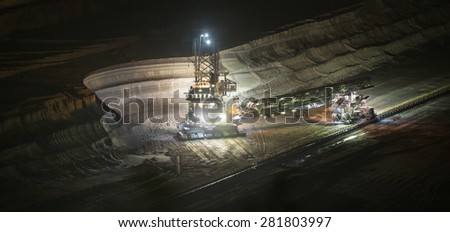 bucket-wheel excavator at night in open-cast coal mining hambach germany
