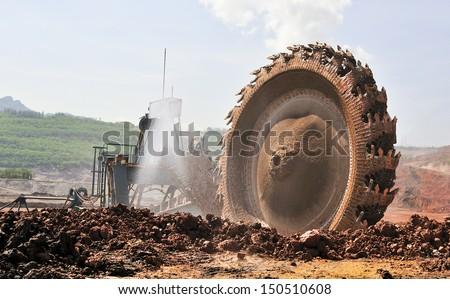 Bucket- wheel excavator at work - stock photo