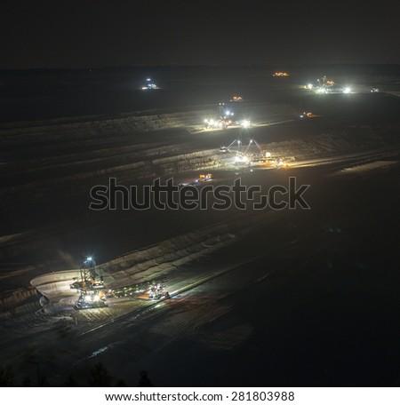 bucket-wheel excavators at night in open-cast coal mining hambach germany - stock photo